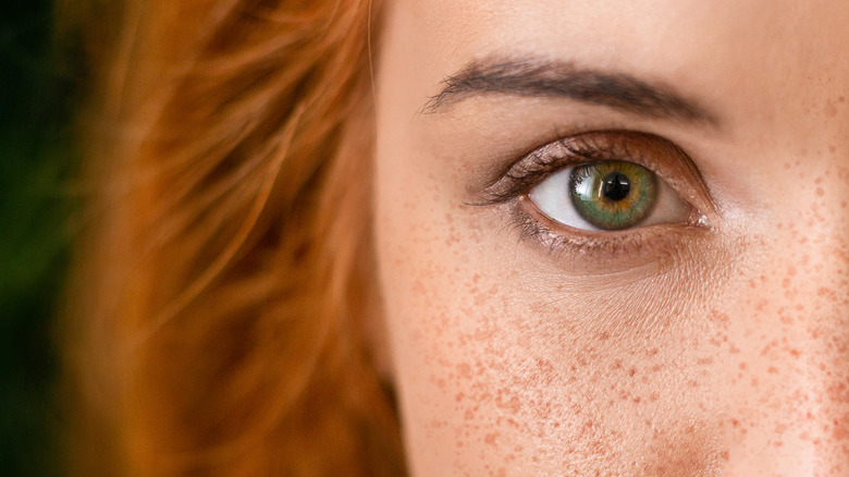 close up of red-haired woman with green eyes